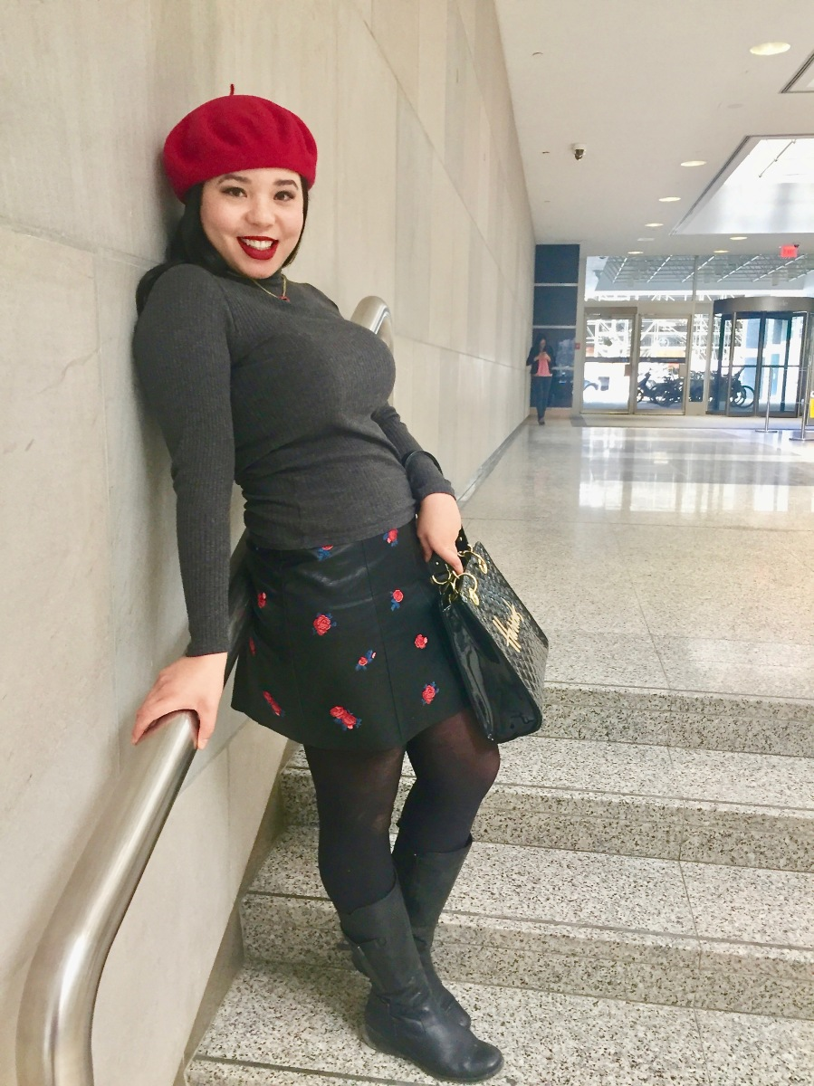 A Red Beret And A Leather Skirt